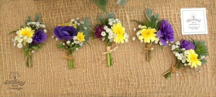 buttonholes on hessian with yellow and  blue flowers